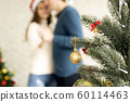 Couple happy together dancing in a decorated room 60114463