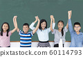 Group of young diversity Asian children and teacher smiling rising hands show glory in classroom.  60114793