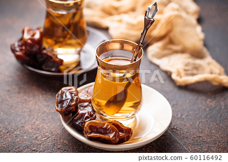 Traditional arabic tea and dry dates 60116492