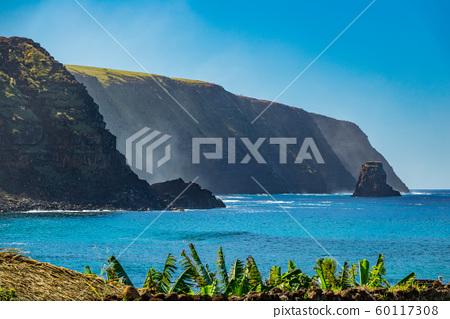 Rough coastline in Easter Island, profile view, Chile 60117308