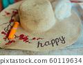 Patterned Straw hat on foam box in summer day 60119634