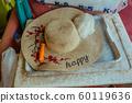 Patterned Straw hat on foam box in summer day 60119636