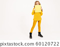 european girl holding blank paper on white studio background. 60120722