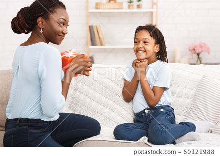 Black woman congratulating her child with birthday 60121988