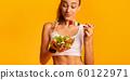 Fitness Girl Eating Fresh Vegetable Salad Standing In Studio, Panorama 60122971