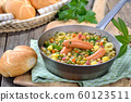 Hearty pea stew with potatoes, bacon and Viennese sausages 60123511