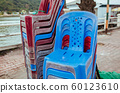 Plastic chairs on the street in summer Asia 60123610
