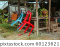 Plastic chairs on the street in summer Asia 60123621