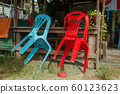 Plastic chairs on the street in summer Asia 60123623