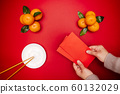Flat lay Chinese lunar new year traditional food and offering red envelope on table top 60132029