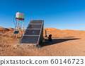 Solar energy panel and water tank in the desert. Sun as energy resource concept 60146723