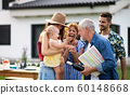 Portrait of multigeneration family outdoors on garden barbecue. 60148668