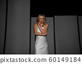 Fashioned model is posing in artistic lights of projector. 60149184