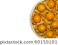 Cape gooseberry on wooden dish in white background. Concept of health care or herb. Top view and copy space for text. 60150101