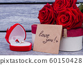 Golden ring, roses and love message. 60150428