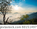 Sunrise and the mist in winter morning 60151497