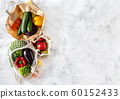 Vegetables and fruits in net and paper bags on white background 60152433