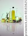 Olive oil bottles, olive branch and Cooking oils 60163625
