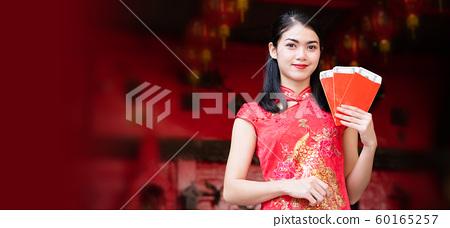 Beauty Asian woman wearing a red cheongsam 60165257