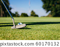Close Up of Golf club and ball in grass. 60170132