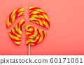 Lollipop broken into pieces on pink background, 60171061
