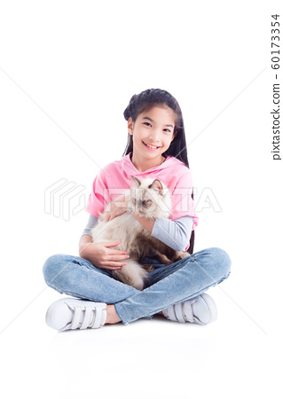 Pretty asian girl sitting on the floor and holding her cat with smiles over white  60173354