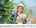 Beautiful asian farmer holding fresh melon  60173915