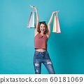 Happy young woman hand holding shopping bag 60181069