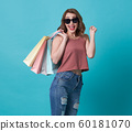 Happy young woman hand holding shopping bag 60181070