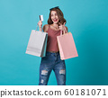 happy woman showing credit card and shopping bag 60181071