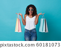 Happy young woman hand holding shopping bag 60181073