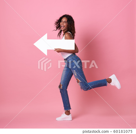 african woman jumping and her arrow at copy space 60181075