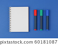 open notebook with colored markers 60181087