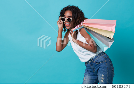 Happy young woman hand holding shopping bag 60182275