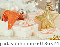 Christmas gifts under the Christmas tree 60186524
