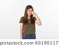 disgusted young blonde closing her nose with her fingers. Isolated over white background. 60190117