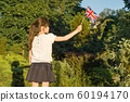 Little girl with flag of Great Britain in her hand, in sunny summer park 60194170