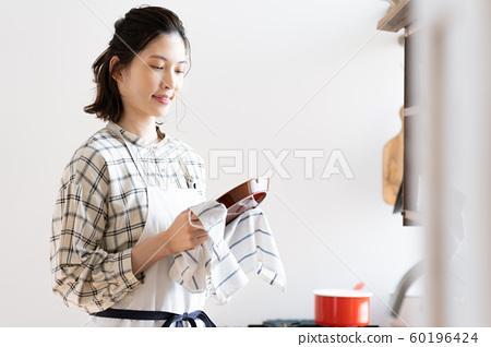 Woman housework kitchen 60196424