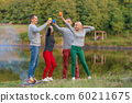 Picnic with friends in at lake near bonfire. 60211675