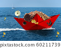 Red paper fishing boat with fishing nets sails in the blue sea 60211739
