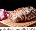 Still life with baked sliced bread loaf. Red 60212454