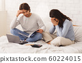 Young pregnant couple suffering from lack of money 60224015