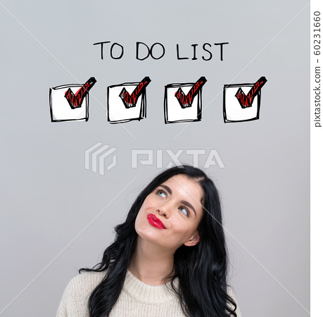 To do list with happy young woman 60231660