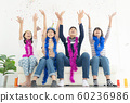 Group of children play with air balloons, confetti 60236986