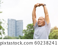 Asian senior man stretching his arms in the air 60238241