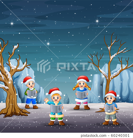 Children singing christmas carols on winter landscape 60240301