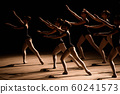 A choreographed dance of a group of graceful pretty young ballerinas practicing on stage 60241573