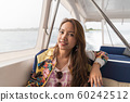 Asian beautiful woman siting on the speed boat. 60242512