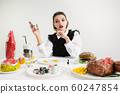 We are what we eat. Woman's eating plastic food, eco concept 60247854
