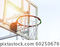 Old basketball hoop with sunlight in the sport 60250676